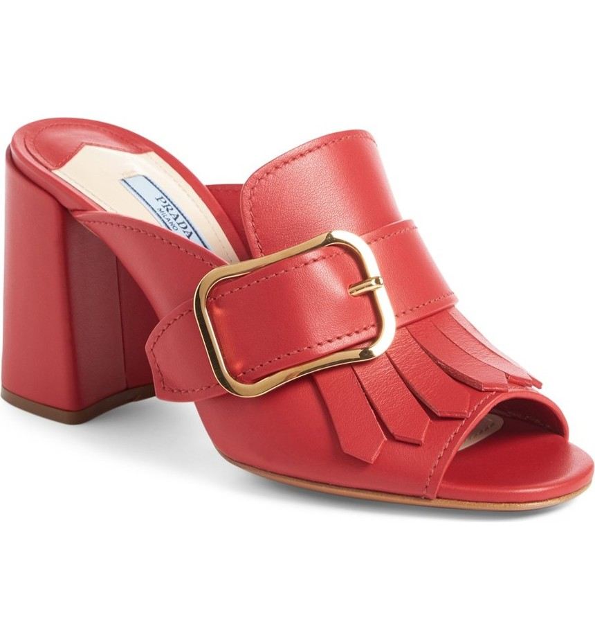 Prada Kiltie Fringe Buckle Strap Mule. Available in red, black. Nordstrom. Was: $750. Now: $449.