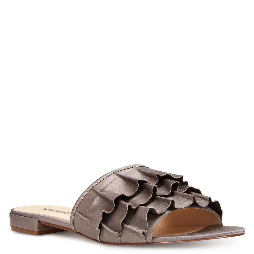 Nine West Ivarene Slide Sandals. Available in multiple colors. Nine West. $79 + $30 off with $100 or more in your cart.
