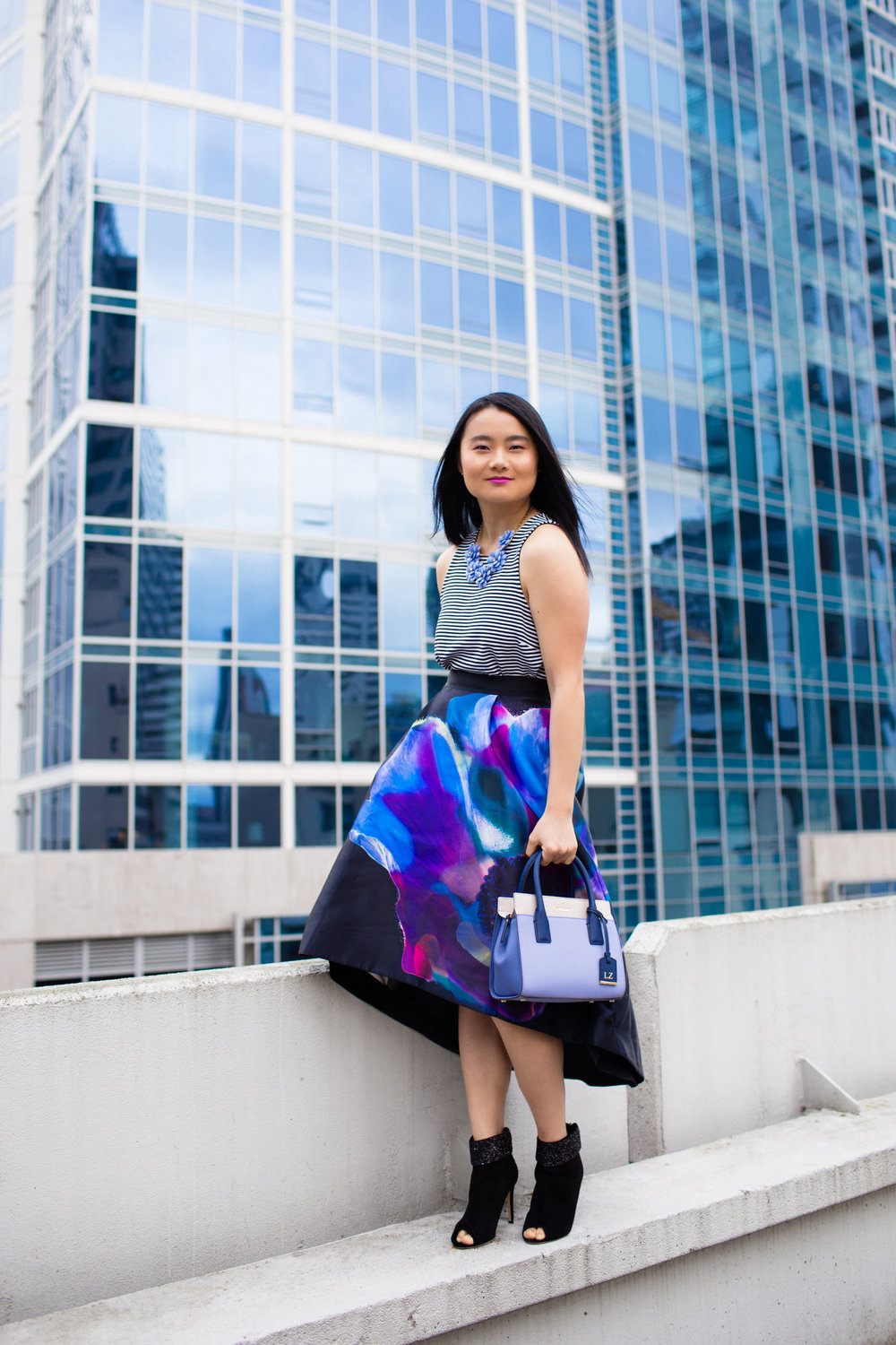 While this photo of my client,  Lusha , shows how to balance your frame with prints. We've placed a print on top with a print + an a-line skirt to balance the bottom. Because she has broad shoulders, if she had this top on with a pencil skirt in the floral print, she still would not have a balanced frame. Make sense?