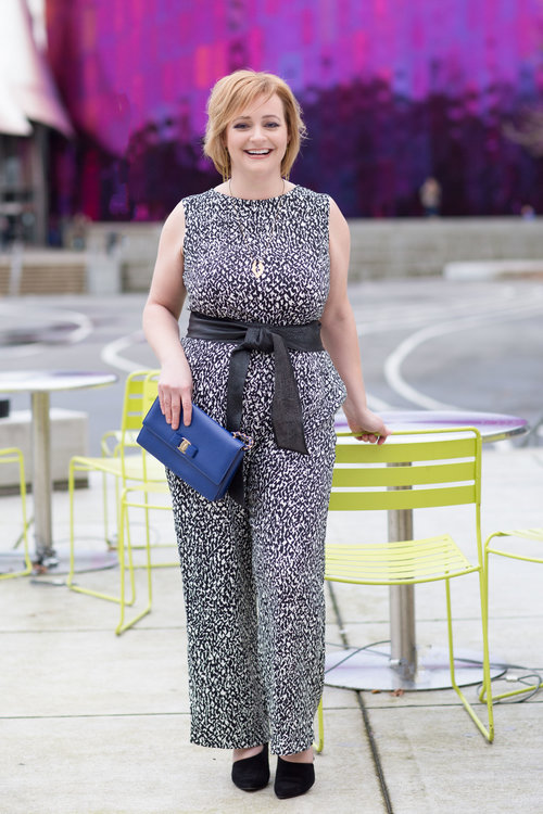Mandy  loves bold prints and I knew Marimekko was for her. But, the shapeless shifts aren't flattering for her frame. So, we ordered this jumpsuit and had the tailor shorten it and give it a waist.