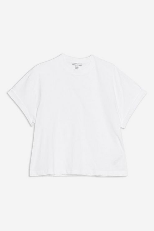 Any Basic white Tee or Button up would work. This one is from Topshop for only $18