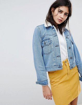 ASOS DESIGN denim shrunken jacket with fleece collar in mid wash blue $64