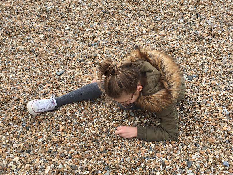 girl beachcombing.jpg