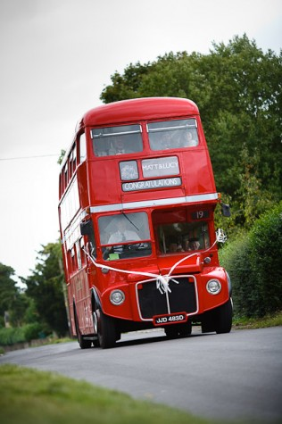 Guests arrived at the church in a red London routemaster bus