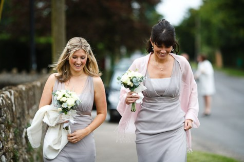The two bridesmaids wore taupe chiffon dresses by Dessy