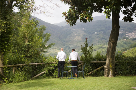 Groom looking out over great Tuscan landscape - photo by Pearl Pictures