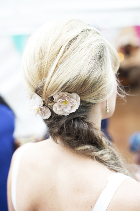 Detail of flowers in brides' hair by Gil Fox