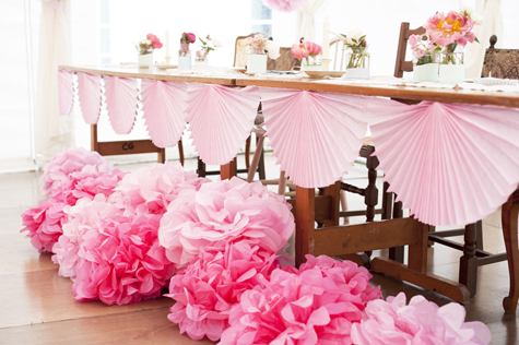 Pompoms and fans decorating the wedding tables