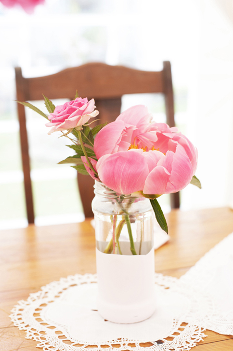 Pink peony in jar on table