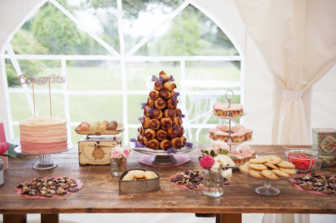 Table with wedding cake, croque en bouche profiteroles and other sweet treats
