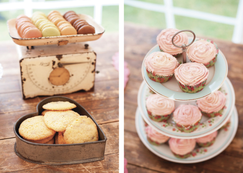 Biscuits, macaroons and a cake stand with cupcakes