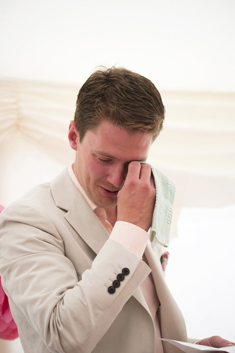Best man wiping away tears