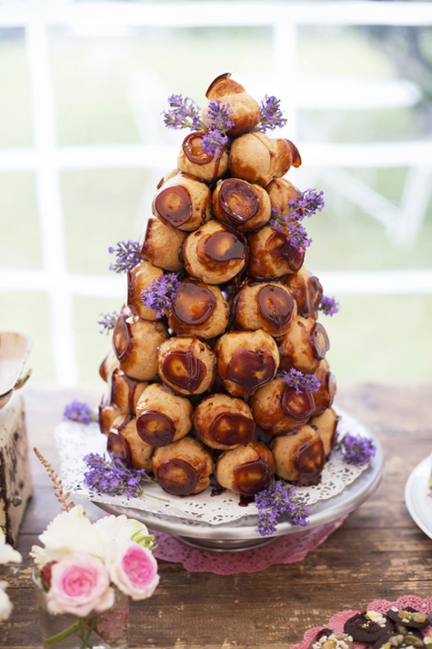 Croque en bouche profiterole tower with lavender sprigs