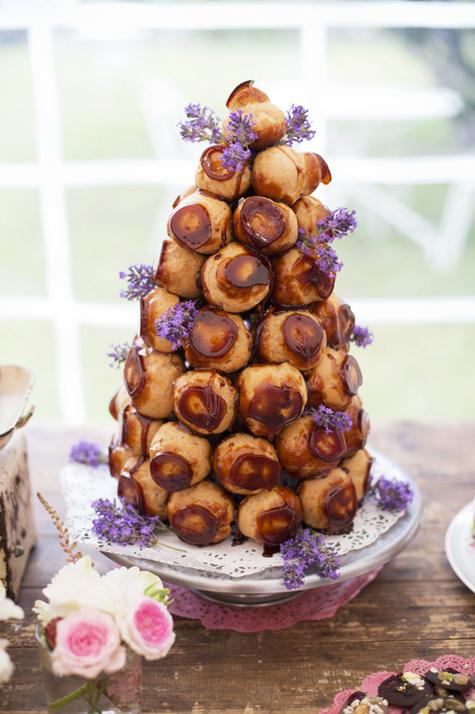 Croque en bouche profiterole tower with lavender sprigs