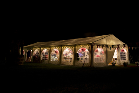 Exterior shot at night of marquee decorated with bunting