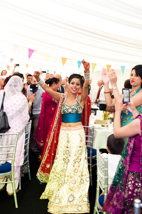 Bride dancing in marquee