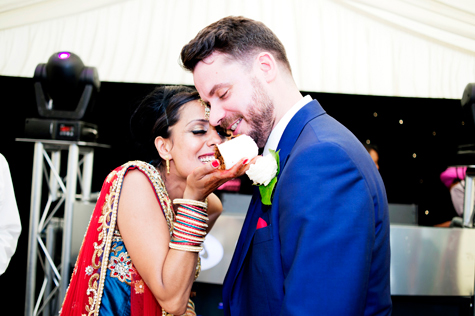 Bride feeding cake to groom