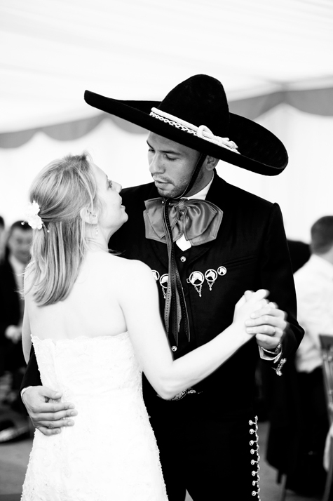 Black and white shot of bride and groom dancing looking into each others' eyes