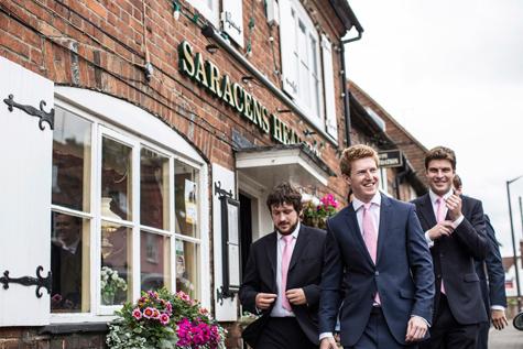 Groom and groomsmen outside the Saracens Head Inn in Amersham