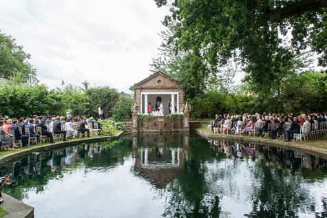 Wedding ceremony in Grotto with lake and guests