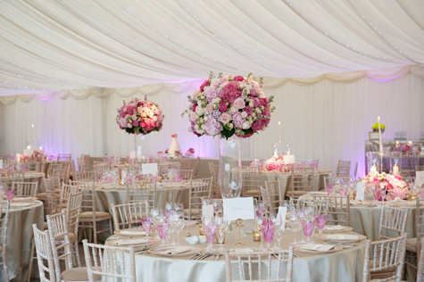 interior shot of marquee with reception tables and decorations