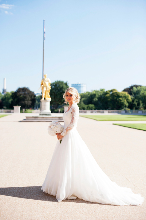 Bride in front of gold statue in Central London