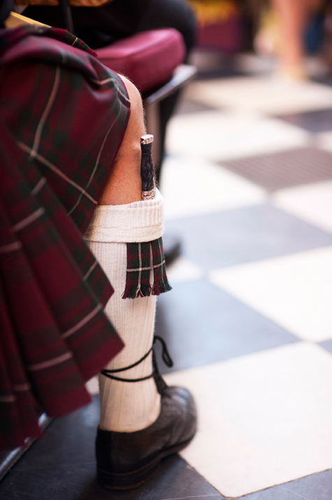Detail shot of wedding guest's leg and traditional kilt
