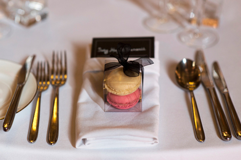 Detail shot of place setting with cutlery and macaroon favour