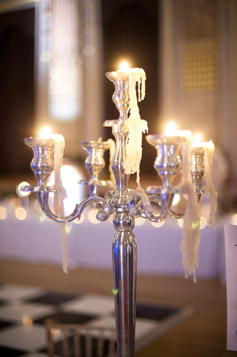 Detail shot of candelabra with low burning candles