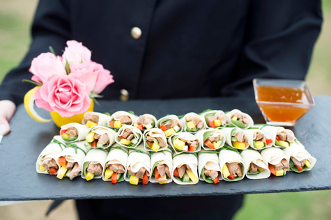 canapes on tray with flower decoration and dip