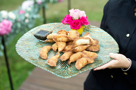Gyoza canapes on platter with flower decoration