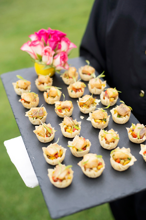 Canapes on tray with flower decoration