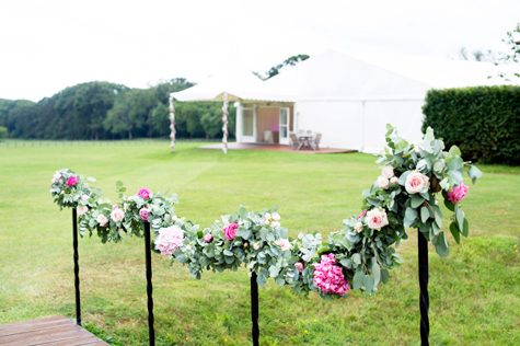 floral decorations on poles outside marquee
