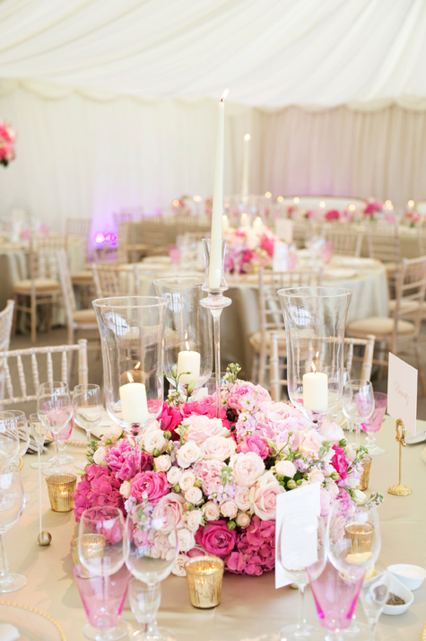 interior of marquee reception tables with floral decorations