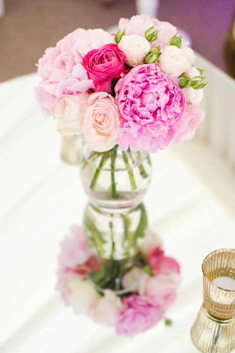 Close up of vase with pink roses and peonies