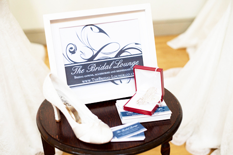 Detail shot of The Bridal Lounge stand, with shoe and jewellery on a small stool