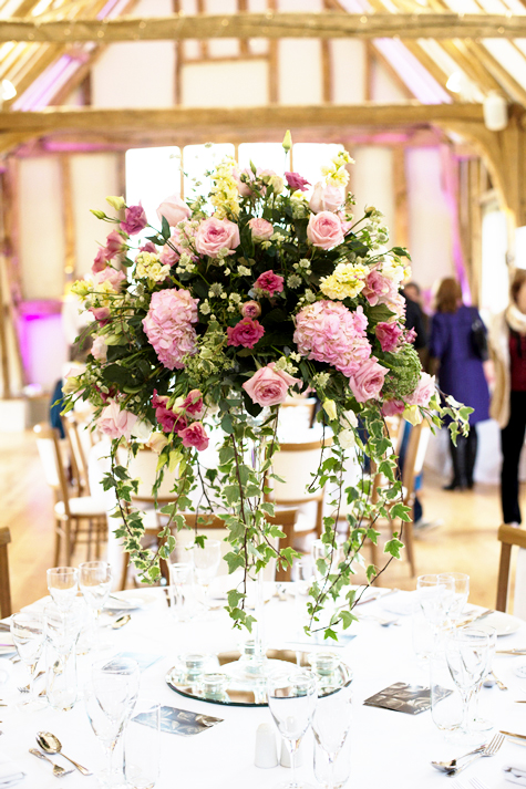 Detail shot of floral table centre display in shades of pink