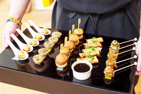 Tray with various canapés and dipping sauce