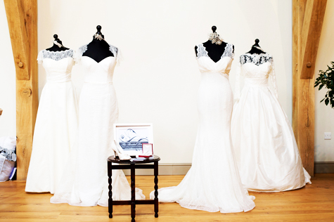 Four mannequins wearing white wedding gowns