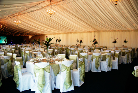 Interior of marquee with tables dressed