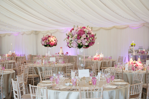 Interior of marquee with dressed tables and floral decorations