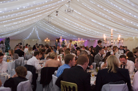 Interior of marquee with guests at tables