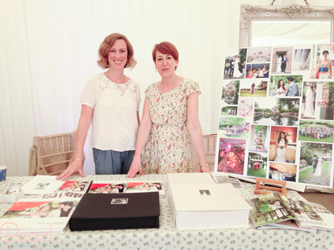 Jemma Watts and Fran Tehan at the Pearl Pictures stand showing albums and photo displays