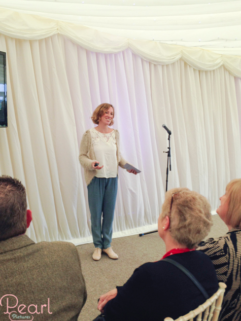 Jemma giving talk on wedding photography in marquee