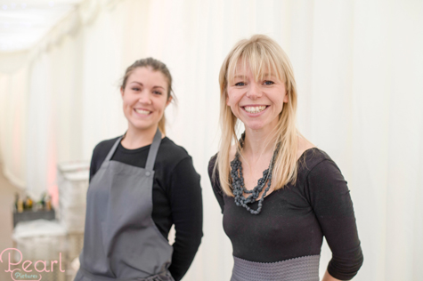 The smiling ladies from Kalm Kitchen at their stand