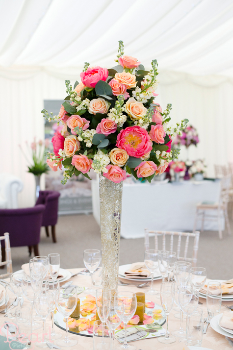 Floral table centrepiece and dressed table in marquee