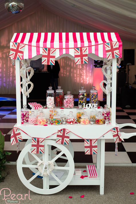 Sweetie Carts London stand with union jack bunting and sweets in jars