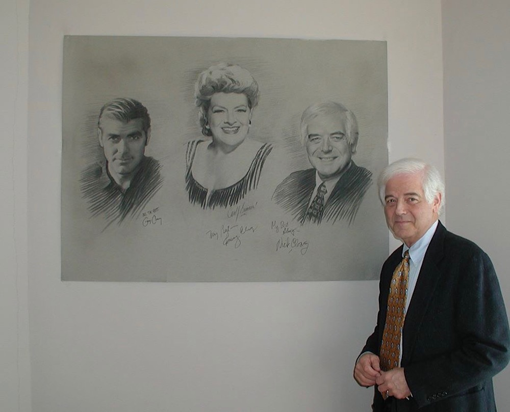Nick Clooney autographing  Brushes With Greatness  triple charcoal portrait drawing