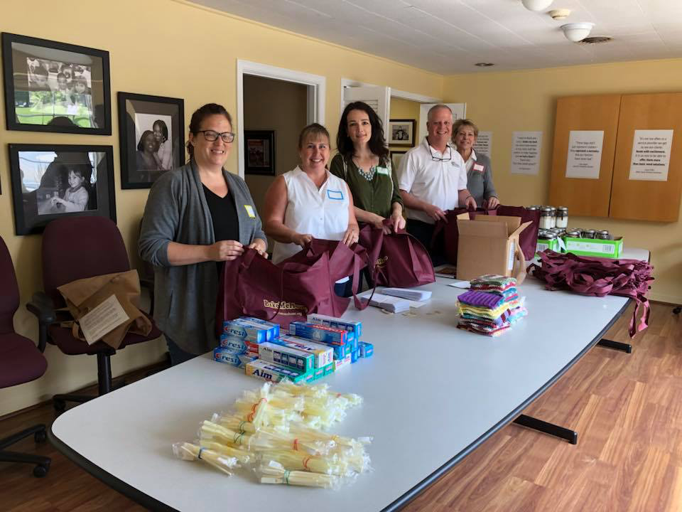 From left, Kimberly Masco, Donna Ellis, Joanne Skinner, Bruce Berno, and Kathleen Blain put together Bake Me Together cookie mix tote bags for families and kids in need on June 7 in Cincinnati.