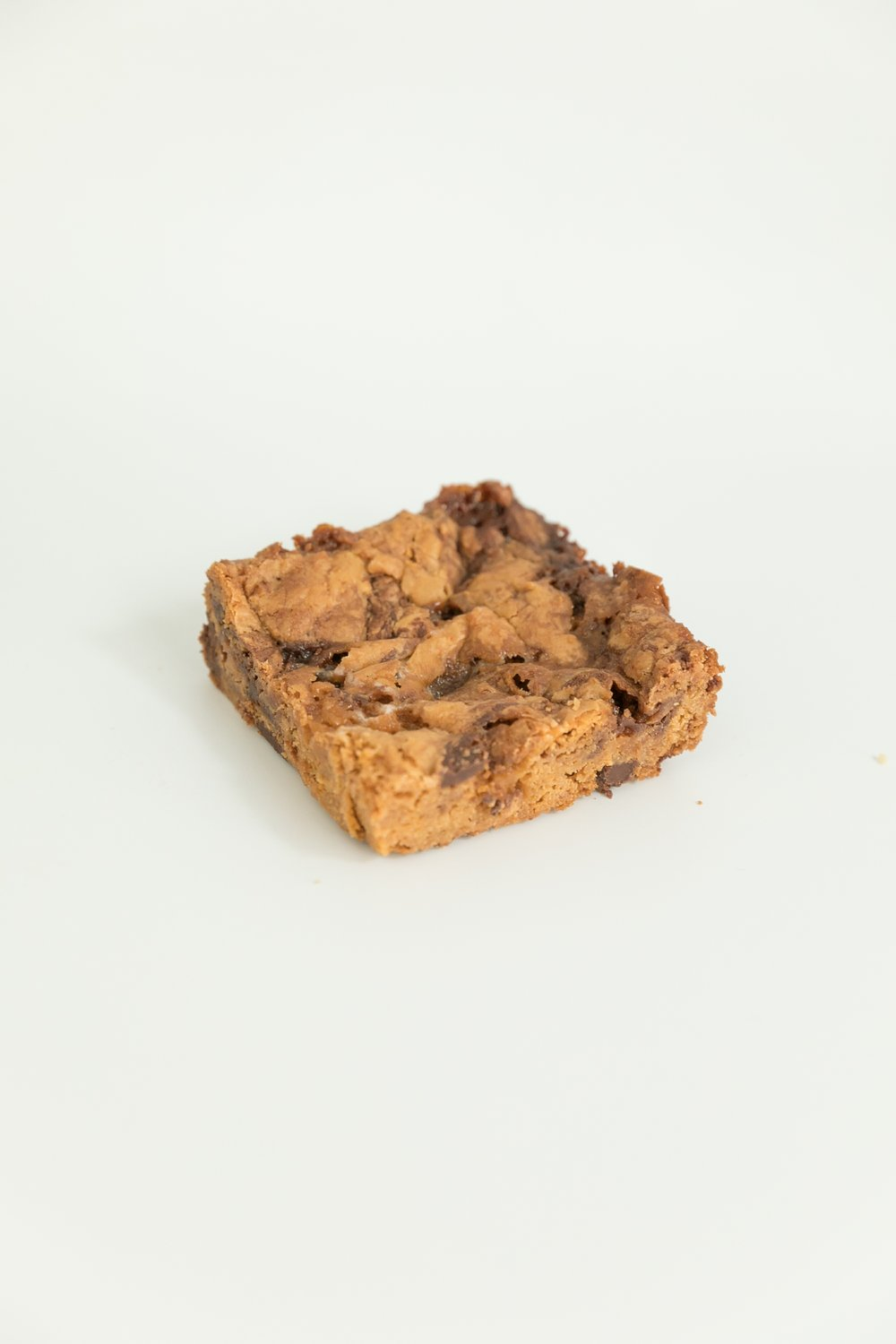 surfer squares are a mixture of butterscotch, chocolate and marshmallow for a caramel-like flavor